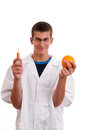 Young scientist happy to do experiments with fruit fruits concept for genetically modified foods gmo Royalty Free Stock Images