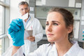 Young scientist looking at slide Royalty Free Stock Photo