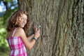 Young scientist looking at tree girl with a lupe Stock Photography