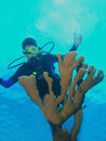 Young scuba diver and fire coral Royalty Free Stock Photo