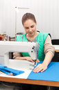 Young seamstress at work Stock Photo