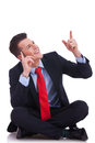 Young seated business man pointing Royalty Free Stock Photo