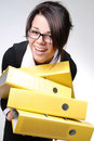 Young secretary with yellow folders Royalty Free Stock Image