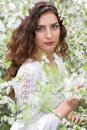 Young seductive brunette portrait of posing in blooming garden Royalty Free Stock Image