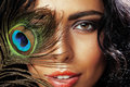 Young sensitive brunette woman with peacock feather eyes close up on green smiling, lifestyle people concept Royalty Free Stock Photo