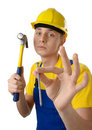 Young serene worker with hammer and nail Royalty Free Stock Photo