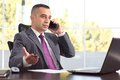 Young And Serious Boss Or Businessman Talking On The Phone Royalty Free Stock Photo