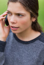 Young serious girl talking on the phone Royalty Free Stock Image