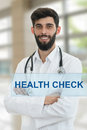 Young serious handsome bearded doctor with white coat and stethoscope. Royalty Free Stock Photo