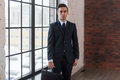 Young serious man standing near office window manager director boss entrepreneur employer Royalty Free Stock Images
