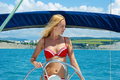 Young sexual woman on sail boat Stock Photography