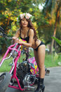 Young sexy Asian woman in black lingerie on pink motorcycle Royalty Free Stock Photo