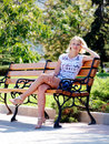 Young blond girl in summer park