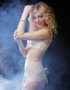 Young sexy blond woman in lingerie over dark background Royalty Free Stock Images