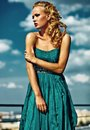 Young sexy blond woman model  in evening dress Royalty Free Stock Photo