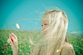 Young  Sexy  blonde   on background of green meadow Royalty Free Stock Photo