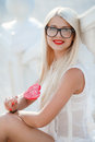 Young sexy blonde woman with heart shaped lollipop Royalty Free Stock Photo
