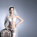 Young sexy bride in erotic lingerie over blue Stock Photos