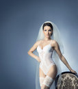 Young sexy bride in erotic lingerie over blue perfect female body bridal grey background Stock Photo
