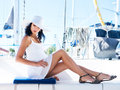 Young and sexy brunette woman relaxing on a boat Royalty Free Stock Photo