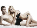 A young and sexy couple posing in black lingerie caucasian erotic the image is isolated on white background Royalty Free Stock Photo