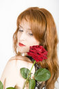 Young sexy elegant woman with red rose Royalty Free Stock Photo