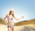 Young and sexy girl in american swimsuit makes the hitch hiking Royalty Free Stock Photography