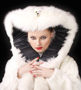 Young sexy girl in a fur coat Royalty Free Stock Photography