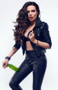 Young sexy girl with long hair in leather jacket with beer Royalty Free Stock Photo