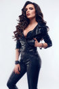 Young sexy girl with long hair in leather jacket Royalty Free Stock Photo