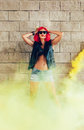 Young sexy girl in red wig and black jacket having fun in yellow smoke outdoors lifestyle Royalty Free Stock Images