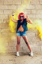 Young sexy girl in red wig and black jacket having fun in yellow smoke outdoors lifestyle Royalty Free Stock Photo