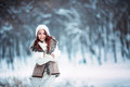 Young and sexy  girl wearing  scarf and hat in winter dress over white Royalty Free Stock Photo