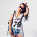Young sexy happy woman looking at camera wearing sunglasses portrait of trendy girl having fun style casual concept lifestyle Royalty Free Stock Photos