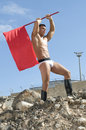 Young sexy man with a red flag Royalty Free Stock Photo