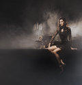 Young sexy witch making the witchcraft in the dungeon beautiful over smoky background halloween image Royalty Free Stock Images