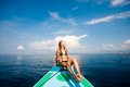 Young sexy woman in bikini enjoying the sun on boat Stock Photography