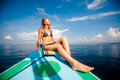 Young sexy woman in bikini enjoying the sun on boat Stock Photos