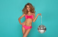 Young sexy woman in pink lingerie holding disco ball Stock Images