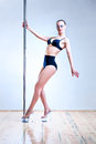 Young sexy woman pole dance Stock Photos