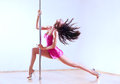 Young sexy woman pole dance bright white colors Royalty Free Stock Image