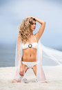 Young and sexy woman posing on the beach sporty beautiful blond a tropical Stock Images