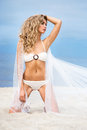 Young and sexy woman posing on the beach sporty beautiful blond a tropical Royalty Free Stock Image