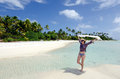 Young sexy woman relaxing on a deserted tropical island in aitutaki lagoon cook islands Stock Photo