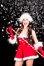 Young and sexy woman in santa costume with snow Stock Photos