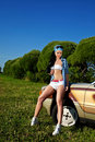 Young sexy woman stay near retro car Royalty Free Stock Image