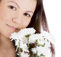 Young sexy woman with a white flower. Royalty Free Stock Photo
