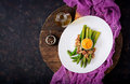Young shoots of asparagus with ham and chicken egg yolk Royalty Free Stock Photo