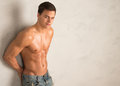 Young shredded man against a wall Royalty Free Stock Photo