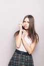 Young shy beautiful brunette woman posing indoors against wall lady Royalty Free Stock Photography